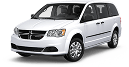 Dodge Grand Caravan near Silverado title=