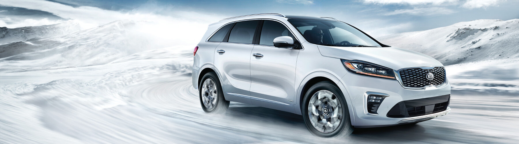 A 2019 Kia Sorento driving through the snow