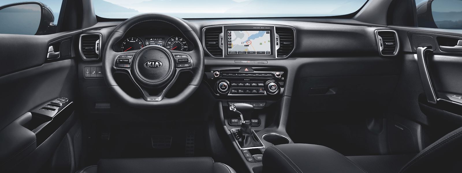 An all black interior shot of the 2019 Kia Sportage dashboard