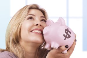 cost-woman-happy-saves-money-shutterstock_166808831