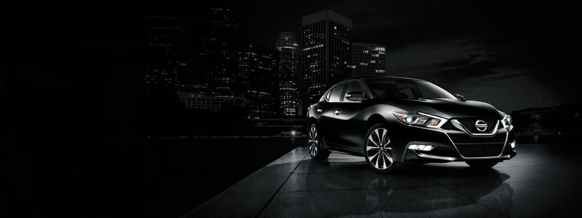 2018 Nissan Maxima parked in with city skyline in the background