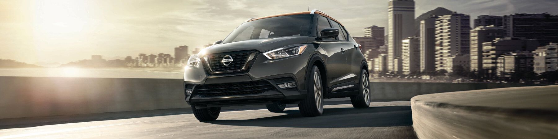 A 2018 Nissan Kicks driving out of the city