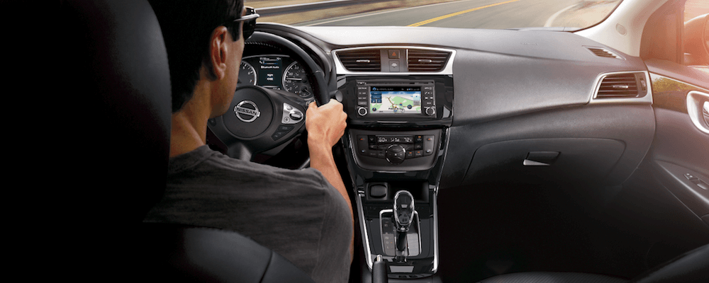 A man driving the 2018 Nissan Sentra