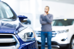 first-time car buyer looks at used car inventory