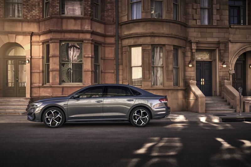 2020 Volkswagen Passat dark gray in front of upscale city neighborhood