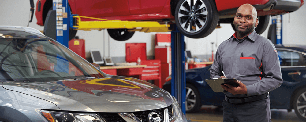 nissan service and repairs - mechanic offering assistance