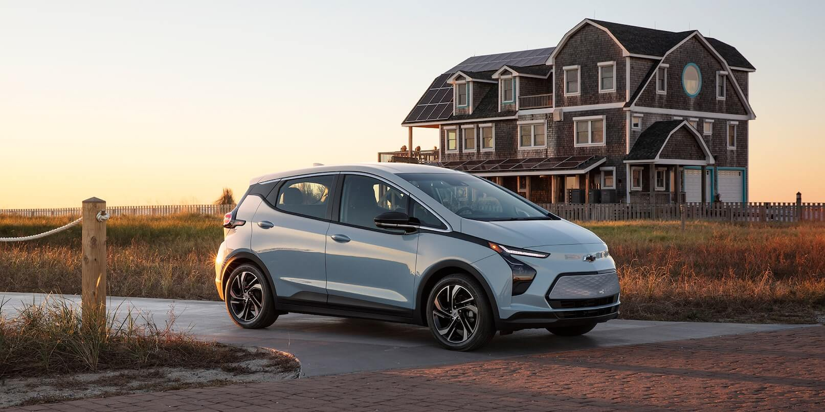 Right-side exterior view of the 2022 Chevrolet Bolt EV driving on the road.