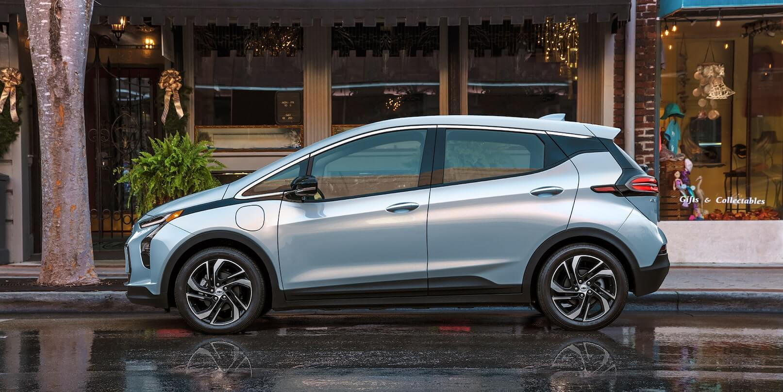 Left-side exterior view of the 2022 Chevrolet Bolt EV parked on the road.
