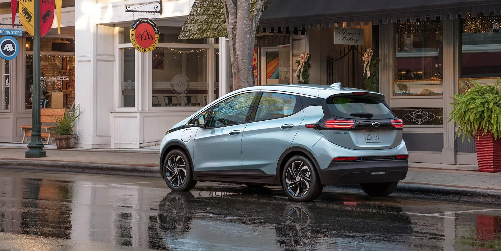 Left-rear side exterior view of the 2022 Chevrolet Bolt EV parked on the road.