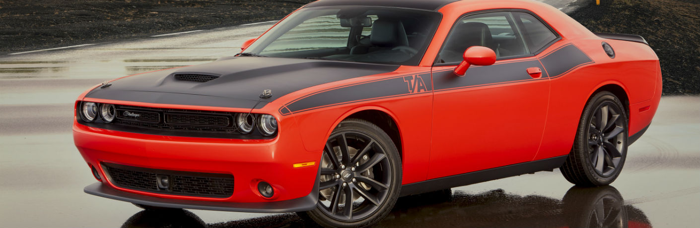 2020 Dodge Challenger exterior shot with red paint color and black racing stripes