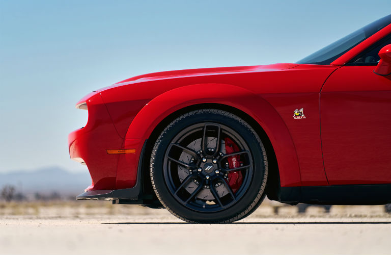 2020 Dodge Challenger exterior side shot with red paint color parked on a desert plain