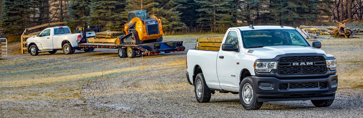 2020 Ram 2500 Tradesman Heavy-Duty trucks working out in a forest field surrounding by machinery