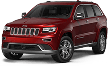Jeep Grand Cherokee near Silverado title=