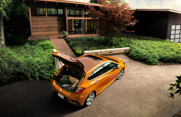 2018 Chevy Cruze hatchback in orange with trunk open