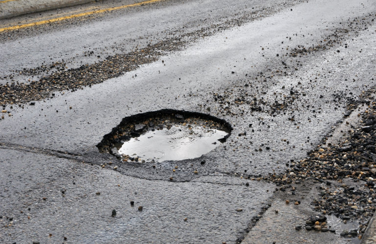 Car damage caused by potholes