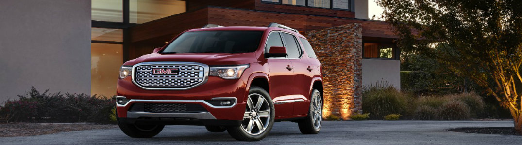 2017 GMC Acadia Denali Trim in red in front of a house
