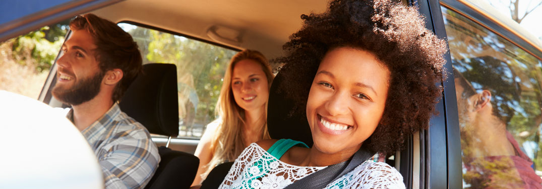 Young people inside a vehicle