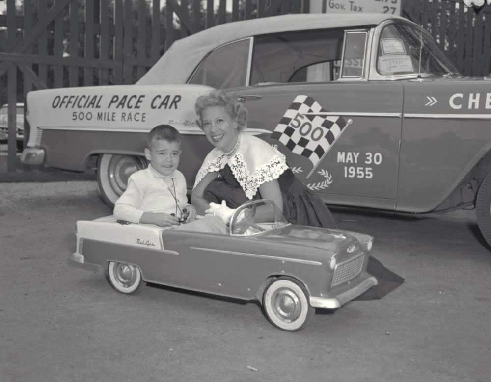 Woman and boy in front of the 1955 Chevy Bel Air Indy 500 Pace Car