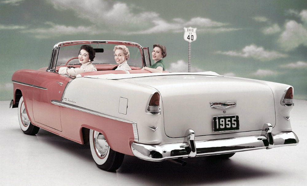 ladies on an imaginary road trip in the convertible 1955 Chevy Bel Air