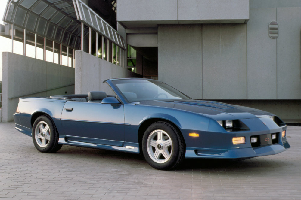 Blue 1992 Chevy Camaro Z28 Convertible with an industrial background