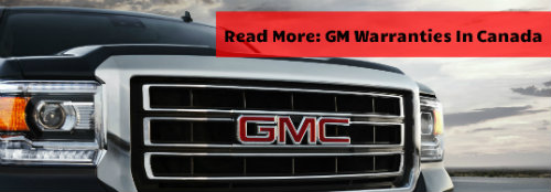 the close-up of a GMC grille with the words Read More: GM Warranties in Canada