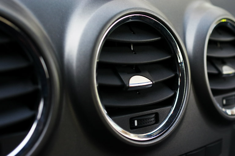 air conditioning and heating vent in a vehicle