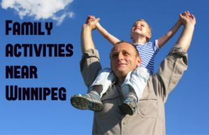 "man holding son on shoulders caption ""family activities near winnipeg"""