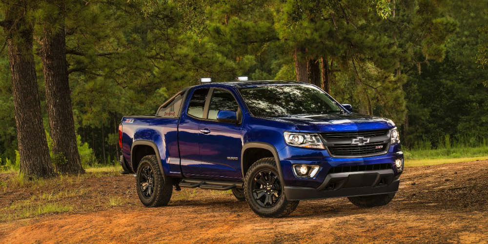 Blue 2016 Chevy Colorado Z71 Trail Boss in the woods