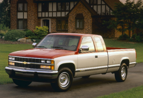 The 1988 Chevrolet C2500 Silverado Fleetside Extended Cab in front of a home