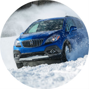 Blue Buick in the middle of cold weather snow driving testing