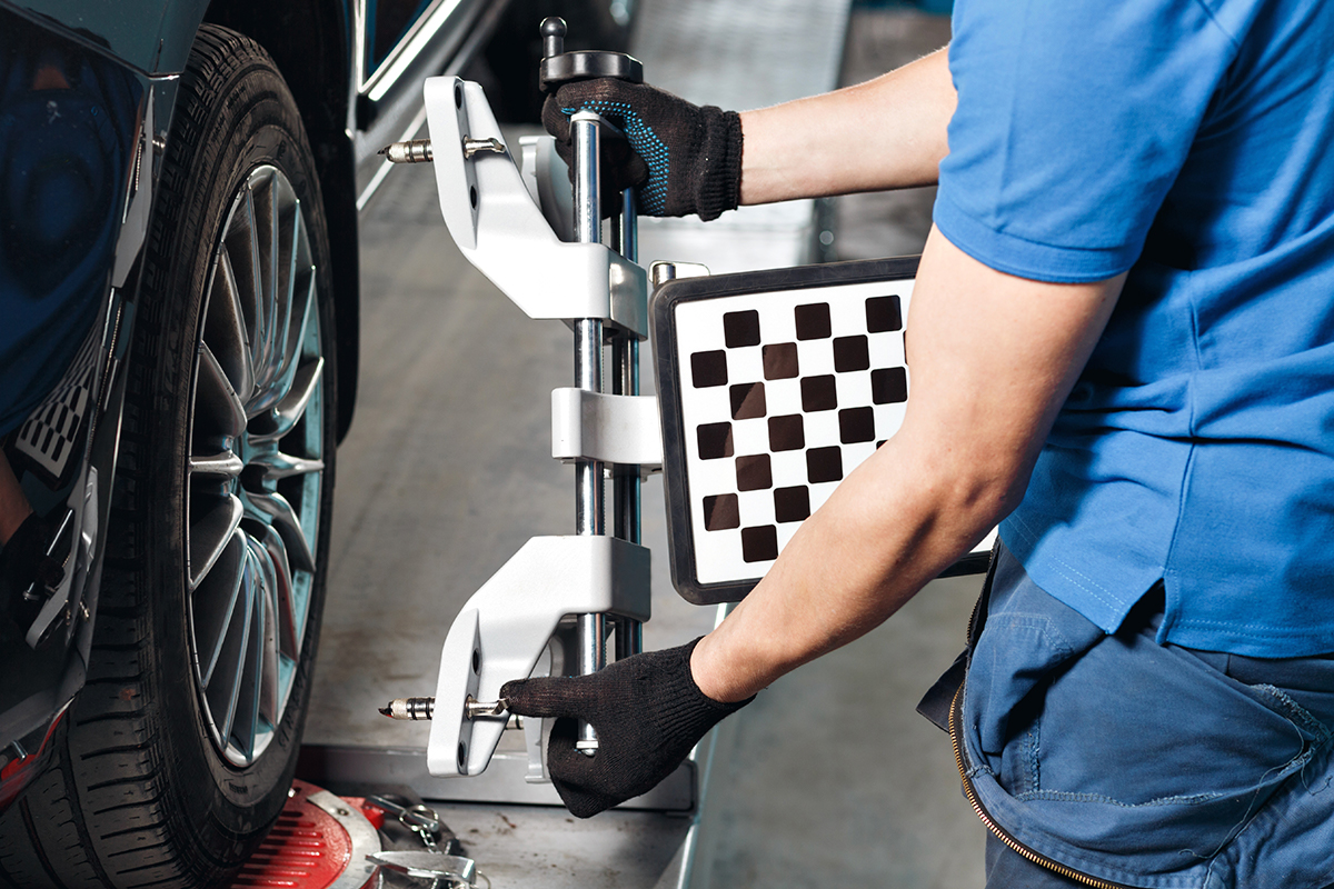 FOUR WHEEL ALIGNMENT AND BRAKE INSPECTION