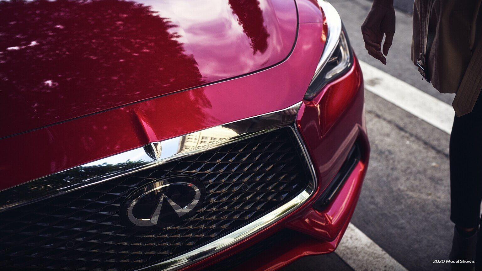 2021 Infiniti Q60 with signature elements including double arch grille