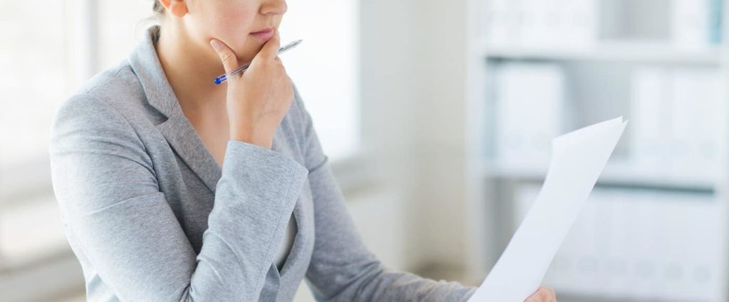 woman reviewing paperwork