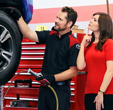 Service technician discussing service with customer.