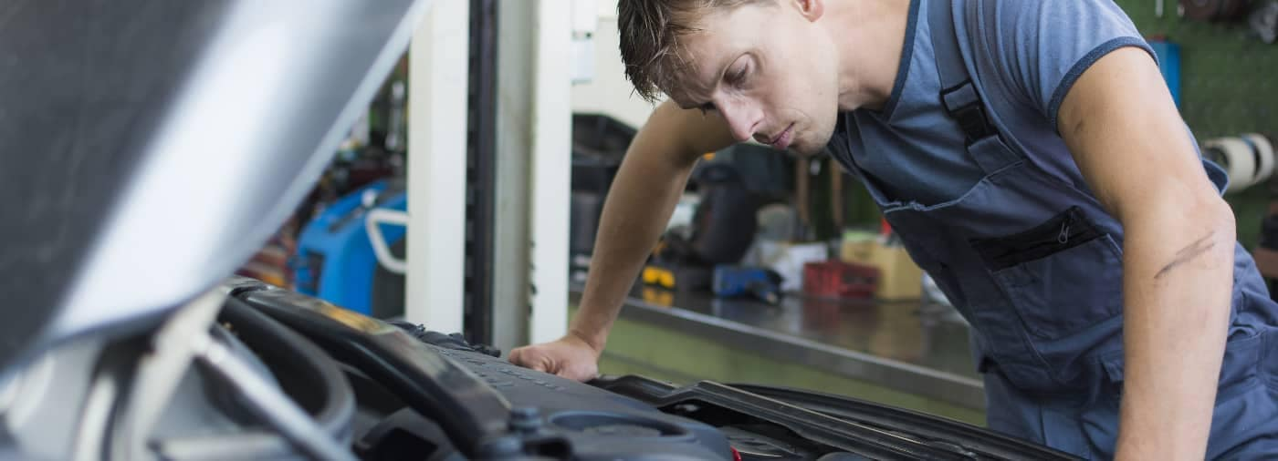 Mechanic looking at a car