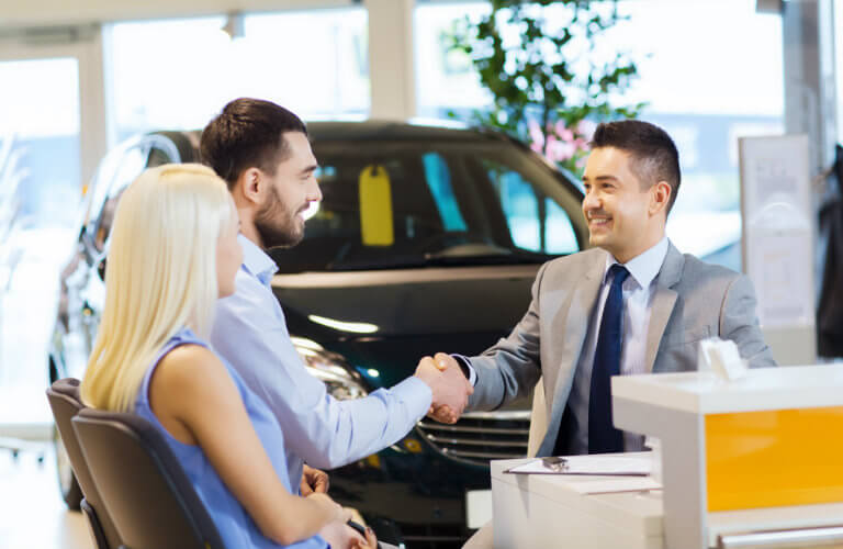 Applying for credit approval at a car dealership