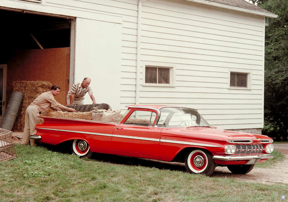 Hardworking 1959 Chevy El Camino being loaded with hay or straw