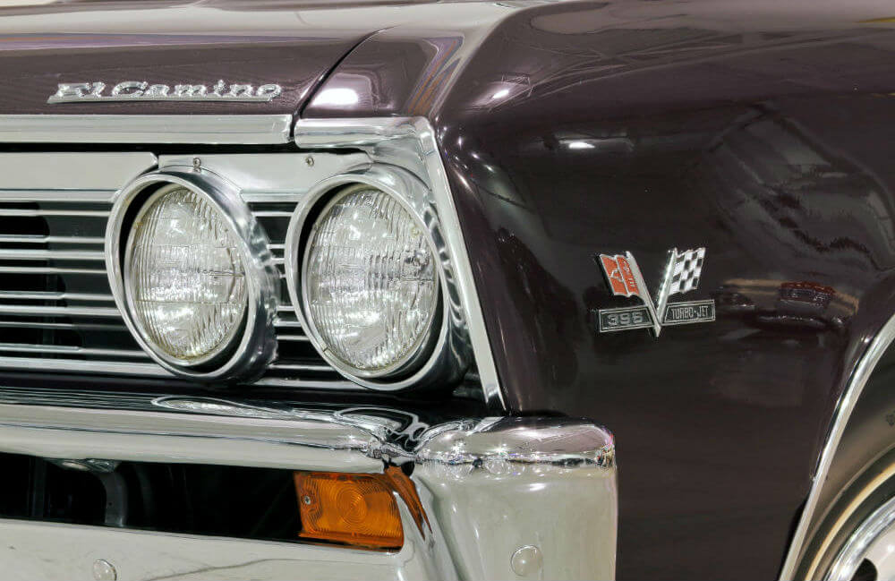 Close-up of a 1967 Chevy El Camino SS headlight with grille and 396 Turbo-Jet branding