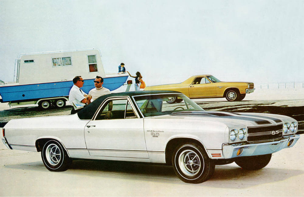 white 1970 Chevy El Camino at the beach