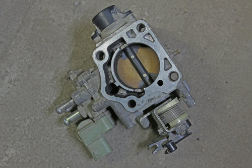 A damaged throttle body from a car may cause a loss of engine power