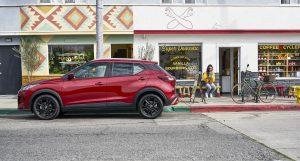 Red 2021 Nissan Kicks ouside coffee shop