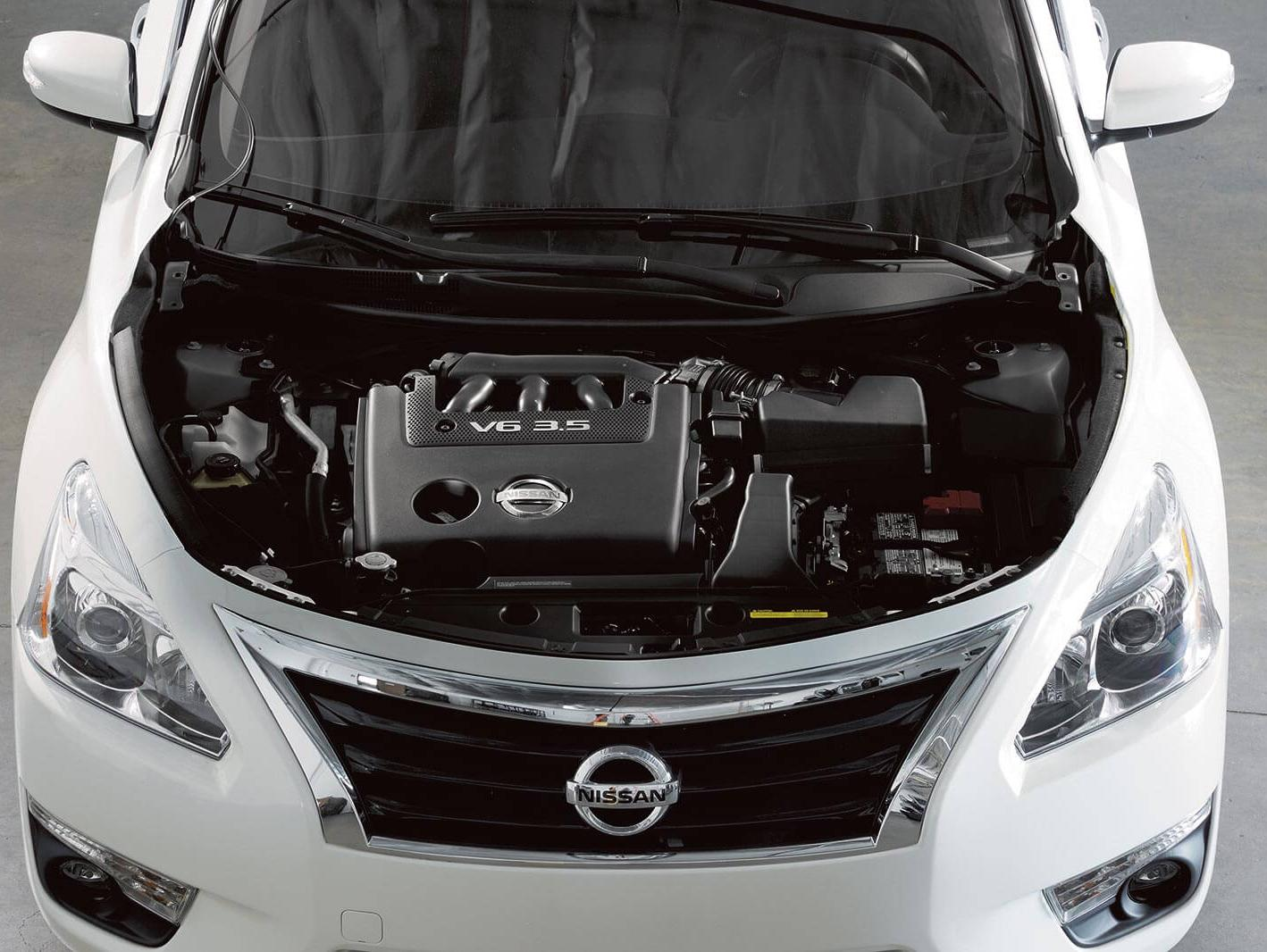 Nissan Vehicle with engine exposed.