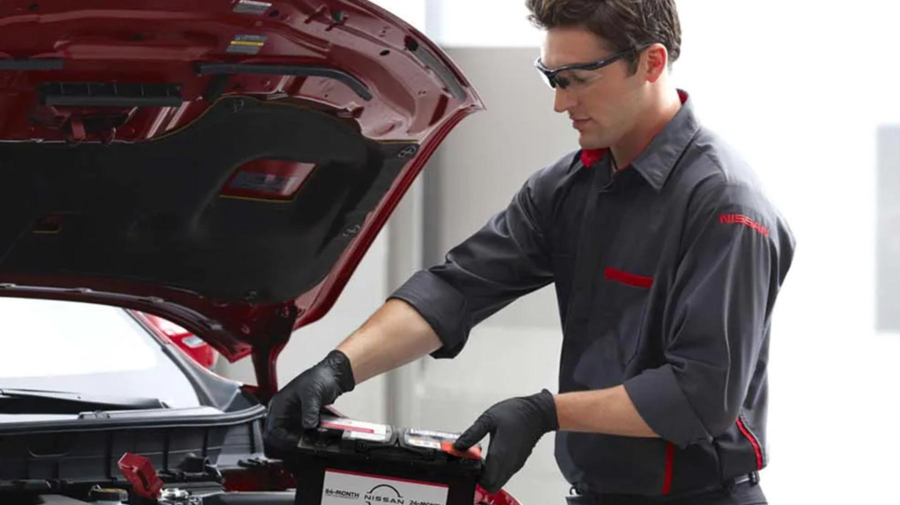 Nissan Technician doing a inspection on a vehicle