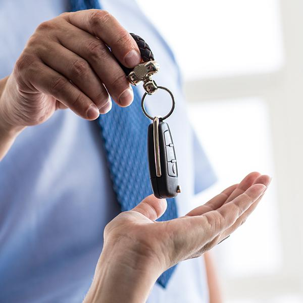 Two hands with car keys
