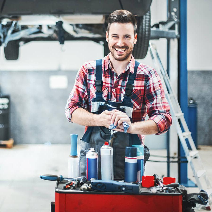 Smiling mechanic in a service garage